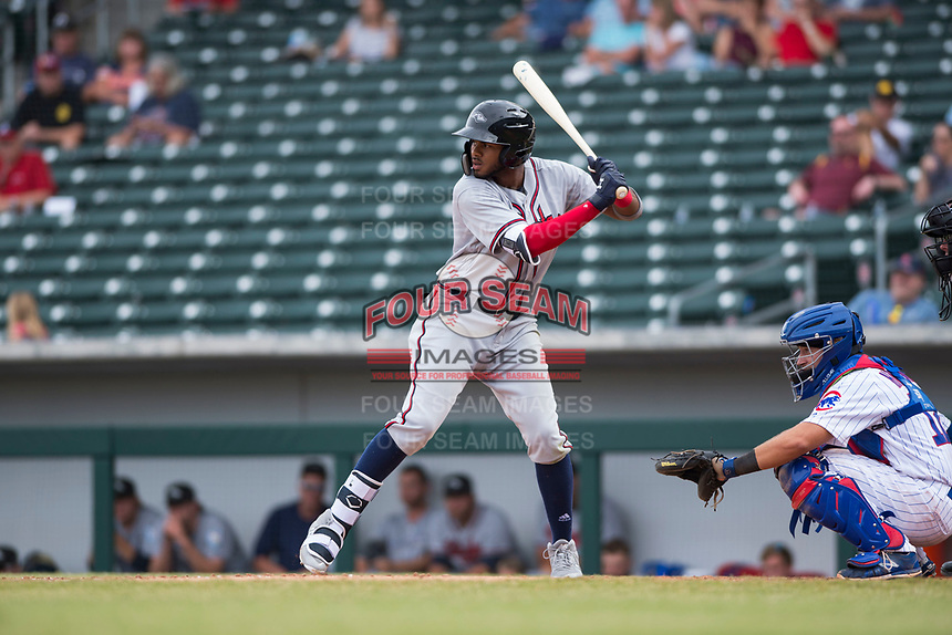 Peoria Javelinas right fielder Izzy Wilson (7), of the Atlanta Braves organization, at bat in front of catcher P.J. Higgins (12) during an Arizona Fall League game against the Mesa Solar Sox at Sloan Park on October 11, 2018 in Mesa, Arizona. Mesa defeated Peoria 10-9. (Zachary Lucy/Four Seam Images)