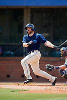 Mobile BayBears catcher Wade Wass (10) follows through on a swing during a game against the Pensacola Blue Wahoos on April 26, 2017 at Hank Aaron Stadium in Mobile, Alabama.  Pensacola defeated Mobile 5-3.  (Mike Janes/Four Seam Images)