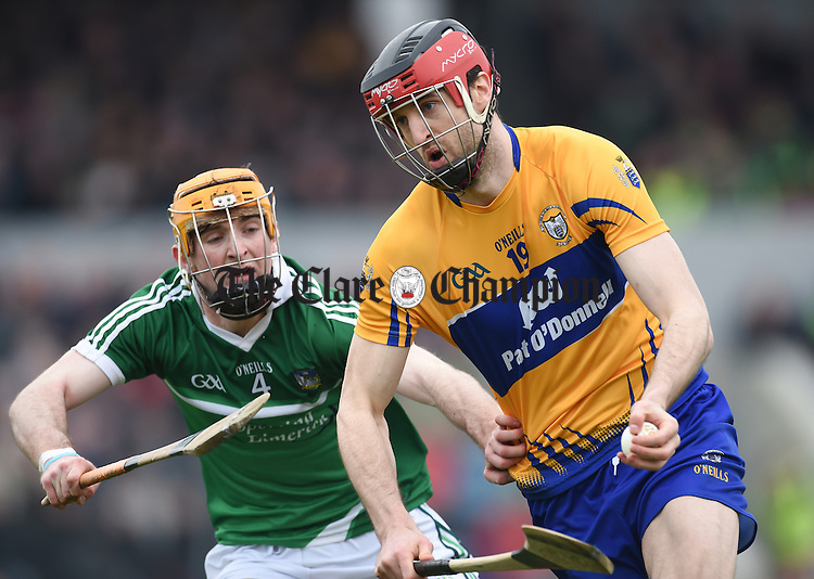 Darach Honan of Clare in action against Richie English of Limerick during their Div. 1b Round 5 game in Cusack park. Photograph by John Kelly.