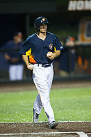 The Buies Creek Astros bat boy brings new baseballs to the home plate umpire during the game against the Wilmington Blue Rocks at Jim Perry Stadium on April 29, 2017 in Buies Creek, North Carolina.  The Astros defeated the Blue Rocks 3-0.  (Brian Westerholt/Four Seam Images)