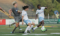 Karen Carney (14) and Formiga (8) of Chicago team up to keep the ball away from Independence midfielder, Lori Lindsey (6).  The Philadelphia Independence shut out the Chicago Red Stars, 3-0 on two goals from Amy Rodriguez and one from Caroline Seger at John A Farrell Stadium in West Chester, Pennsylvania.