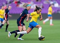 ORLANDO, FL - FEBRUARY 21: Julie Ertz #8 of the USWNT defends Marta #10 of Brazil during a game between Brazil and USWNT at Exploria Stadium on February 21, 2021 in Orlando, Florida.