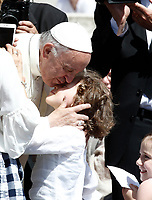 Papa Francesco bacia un bambino al termine dell'udienza generale del mercoledi' in Piazza San Pietro in Vaticano, 7 giugno 2017.<br /> Pope Francis kisses a child at the end of his weekly general audience in St. Peter's Square at the Vatican, on June 7, 2017.<br /> UPDATE IMAGES PRESS/Isabella Bonotto<br /> STRICTLY ONLY FOR EDITORIAL USE