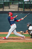 Ryan McCarvel (31) of the Johnson City Cardinals follows through on his swing against the Bristol Pirates at Boyce Cox Field on July 7, 2015 in Bristol, Virginia.  The Cardinals defeated the Pirates 4-1 in game one of a double-header. (Brian Westerholt/Four Seam Images)