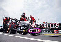 Sep 27, 2020; Gainesville, Florida, USA; NHRA top fuel driver Steve Torrence climbs into his Don Garlits themed dragster during the Gatornationals at Gainesville Raceway. Mandatory Credit: Mark J. Rebilas-USA TODAY Sports
