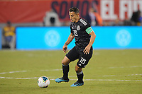 EAST RUTHERFORD, NJ - SEPTEMBER 7: Andres Guardado #18 of Mexico kicks the ball during a game between Mexico and USMNT at MetLife Stadium on September 6, 2019 in East Rutherford, New Jersey.