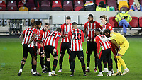 Brentford players social distance ahead of kick-off rather than linking arms for their usual huddle during Brentford vs Bristol City, Sky Bet EFL Championship Football at the Brentford Community Stadium on 3rd February 2021