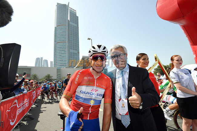 Race leader Red Jersey holder Elia Viviani (ITA) Quick-Step Floors with Liborio Stellino the Italian Ambassador to UAE at sign on before the start of Stage 3 of the 2018 Abu Dhabi Tour, Nation Towers Stage running 133km from Nation Towers to Big Flag, Abu Dhabi, United Arab Emirates. 23rd February 2018.<br /> Picture: LaPresse/Massimo Paolone   Cyclefile<br /> <br /> <br /> All photos usage must carry mandatory copyright credit (© Cyclefile   LaPresse/Massimo Paolone)
