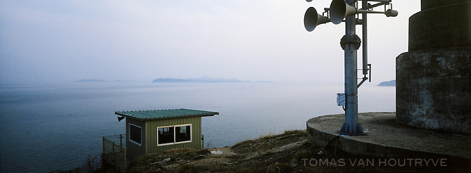 Attack warning sirens are seen near a guard post overlooking the Yellow Sea on Baengnyeong Island, South Korea on April 18, 2012. When an armistice ended open conflict on the Korean peninsula in 1953, there was no agreed upon boundary set up in the Yellow Sea between the two Koreas. Each side has drawn their own line, the South Korean controlled islands of Yeonpyeong, Baengnyeong and Daecheong are located between the two disputed lines.