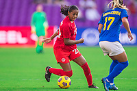 ORLANDO, FL - FEBRUARY 24: Jayde Riviere #20 of the CANWNT dribbles the ball during a game between Brazil and Canada at Exploria Stadium on February 24, 2021 in Orlando, Florida.