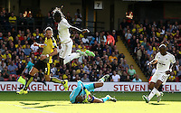 Heurelho Gomes  of Watford gathers the ball under pressure from Eder of Swansea   during the Barclays Premier League match Watford and Swansea   played at Vicarage Road Stadium , Watford