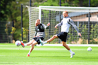 Oli McBurnie (left) vies for possession with Mike van der Hoorn (right) of Swansea City during the Swansea City Training at The Fairwood Training Ground, Swansea, Wales, UK. Friday 24 August 2018