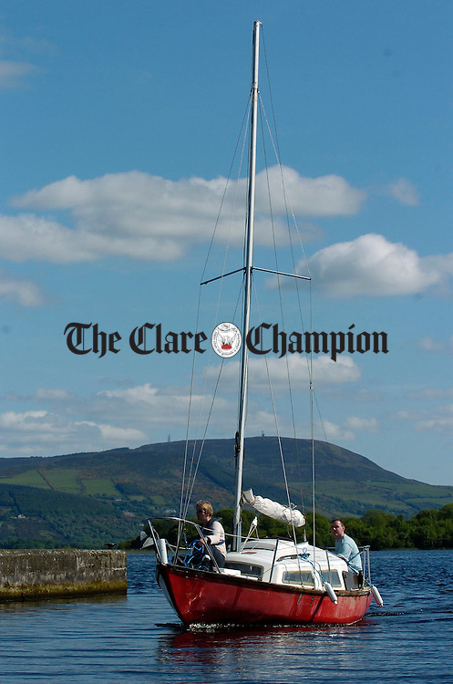A boat enters the harbour at Mountshannon on Lough Derg. Photograph by John Kelly.