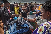Nigeria. Enugu State. Enugu. Ogbete Main Market. People look at a market stall selling clothes. Ogbete main market is the biggest commodity market. Residents of Enugu usually prefer going to Ogbete for major shopping, to buy things in bulk, to purchase quality and original goods, to have access to varieties, to buy new products and to buy goods at wholesale or company price. Apart from clothing and textile materials, prices of commodities in the market are moderately cheap. Enugu is the capital of Enugu State, located in southeastern Nigeria. 1.07.19 © 2019 Didier Ruef