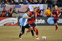 Javier Mascherano (14) of Argentina and Jermaine Jones (13) of the United States battles for the ball. The United States (USA) and Argentina (ARG) played to a 1-1 tie during an international friendly at the New Meadowlands Stadium in East Rutherford, NJ, on March 26, 2011.