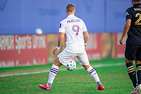 LAKE BUENA VISTA, FL - JULY 20: Chris Mueller #9 of Orlando City SC waits on the ball during a game between Orlando City SC and Philadelphia Union at Wide World of Sports on July 20, 2020 in Lake Buena Vista, Florida.
