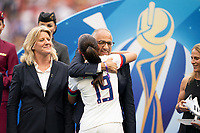 LYON, FRANCE - JULY 07: Alex Morgan and Carlos Cordiero during a game between Netherlands and USWNT at Stade de Lyon on July 07, 2019 in Lyon, France.
