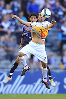 MELBOURNE, AUSTRALIA - JANUARY 26, 2010: Manny Muscat from Wellington Phoenix chests the ball in round 19 of the A-league match between Melbourne Victory and Wellington Phoenix FC at Etihad Stadium on January 26, 2010 in Melbourne, Australia. Photo Sydney Low www.syd-low.com