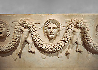 "Close up picture of Roman relief sculpted Sarcophagus of Garlands, 2nd century AD, Perge. This type of sarcophagus is described as a ""Pamphylia Type Sarcophagus"". It is known that these sarcophagi garlanded tombs originated in Perge and manufactured in the sculptural workshops of Perge. Antalya Archaeology Museum, Turkey."