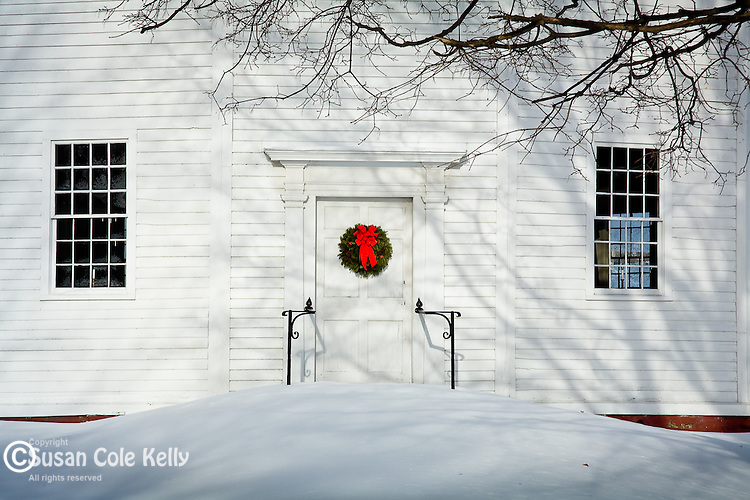 A Christmas wreath on the door of the Old Round Church in Richmond, VT, USA