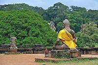 Buddha statue wearing a yellow sash at Angkor Wat, Cambodia