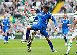 Celtic v St Johnstone....01.04.12   SPL.Fran Sandaza batles with Scott Brown.Picture by Graeme Hart..Copyright Perthshire Picture Agency.Tel: 01738 623350  Mobile: 07990 594431