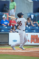 Kyle Higashioka (66) of the Scranton/Wilkes-Barre RailRiders follows through on his swing against the Gwinnett Stripers at Coolray Field on August 16, 2019 in Lawrenceville, Georgia. The Stripers defeated the RailRiders 5-2. (Brian Westerholt/Four Seam Images)