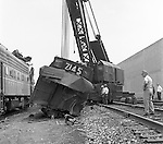 Corliss PA - View of a crane and workers cleaning up an accident site near the train station at Corliss Pennsylvania.  The assignment was for the PA Railroad due to a train derailment near the station.  Brady Stewart Studio was a contract photography studio for the railroad from 1955 through 1965.