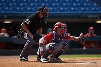 Catcher Ian Moller (40) of Wahlert Catholic School in Dubuque, IA playing for the Cincinnati Reds scout team sets a target as home plate umpire Lance Weems looks on during the East Coast Pro Showcase at the Hoover Met Complex on August 4, 2020 in Hoover, AL. (Brian Westerholt/Four Seam Images)