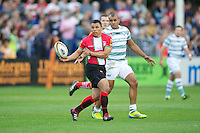 20120803 Copyright onEdition 2012©.Free for editorial use image, please credit: onEdition..Ryan De La Harpe of London Welsh in action against London Irish 7s at The Recreation Ground, Bath in the Final round of The J.P. Morgan Asset Management Premiership Rugby 7s Series...The J.P. Morgan Asset Management Premiership Rugby 7s Series kicked off again for the third season on Friday 13th July at The Stoop, Twickenham with Pool B being played at Edgeley Park, Stockport on Friday, 20th July, Pool C at Kingsholm Gloucester on Thursday, 26th July and the Final being played at The Recreation Ground, Bath on Friday 3rd August. The innovative tournament, which involves all 12 Premiership Rugby clubs, offers a fantastic platform for some of the country's finest young athletes to be exposed to the excitement, pressures and skills required to compete at an elite level...The 12 Premiership Rugby clubs are divided into three groups for the tournament, with the winner and runner up of each regional event going through to the Final. There are six games each evening, with each match consisting of two 7 minute halves with a 2 minute break at half time...For additional images please go to: http://www.w-w-i.com/jp_morgan_premiership_sevens/..For press contacts contact: Beth Begg at brandRapport on D: +44 (0)20 7932 5813 M: +44 (0)7900 88231 E: BBegg@brand-rapport.com..If you require a higher resolution image or you have any other onEdition photographic enquiries, please contact onEdition on 0845 900 2 900 or email info@onEdition.com.This image is copyright the onEdition 2012©..This image has been supplied by onEdition and must be credited onEdition. The author is asserting his full Moral rights in relation to the publication of this image. Rights for onward transmission of any image or file is not granted or implied. Changing or deleting Copyright information is illegal as specified in the Copyright, Design and Patents Act 1988. If you are in any way unsure of your right to publish this