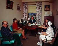 Evangelical Manor Philadelphia, PA. Nursing Home administrator having a meeting in his office.