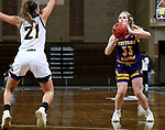 SIOUX FALLS, SD - MARCH 7: Anna Deets #33 of the Western Illinois Leathernecks shoots a three pointer against  Mandy Willems #21 of the UMKC Kangaroos during the Summit League Basketball Tournament at the Sanford Pentagon in Sioux Falls, SD. (Photo by Dave Eggen/Inertia)