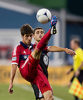 Chris Korb (22) of D.C. United has the ball cleared away from him by Alvaro Fernandez (4) of the Chicago Fire at RFK Stadium in Washington, DC.  D.C. United defeated the Chicago Fire, 4-2.