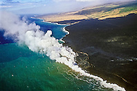 aerial view of lava ocean entry showing lava delta and bench - hot molten lava fed from multiple underground lava tubes, creating massive steam clouds as it crashes with cold ocean, Hawaii Volcanoes National Park, Kilauea, Big Island, Hawaii, USA, Pacific Ocean