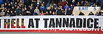 Rangers fans with banner for next weekend's cup game at Tannadice