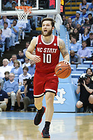 CHAPEL HILL, NC - FEBRUARY 25: Braxton Beverly #10 of North Carolina State University brings the ball up the court during a game between NC State and North Carolina at Dean E. Smith Center on February 25, 2020 in Chapel Hill, North Carolina.