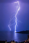 Langland Bay, Swansea, UK, 25th June 2020.<br />The current heatwave and dry weather across the UK comes to a spectacular end with fork lightning off Snapple Point in Langland Bay near Swansea tonight.
