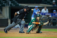 Miami Hurricanes catcher Joe Gomez (40) has a pitch glance off his mitt as home plate umpire Danny Everett looks on during the game against the North Carolina Tar Heels in the second semifinal of the 2017 ACC Baseball Championship at Louisville Slugger Field on May 27, 2017 in Louisville, Kentucky. The Tar Heels defeated the Hurricanes 12-4. (Brian Westerholt/Four Seam Images)