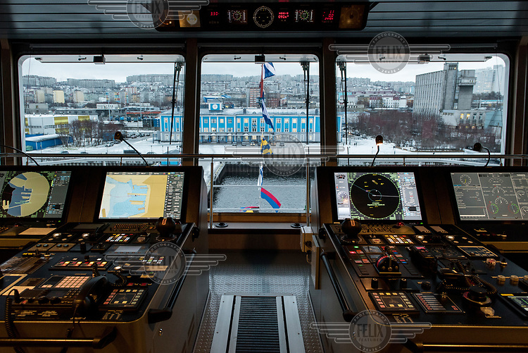 A view from the bridge of the 'Fedor Ushakov', a multifunctional ice-breaking vessel moored in Murmansk prior to its navigation along the Northern Sea Route. The ship is designed to provide the year-round delivery of supplies to offshore oil platforms operating in waters off Sakhalin, and standby assistance for emergency cases. The vessel is able to hold 150 passengers, sufficient in the case of a platform evacuation.