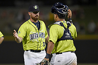 Pitcher Matt Pobereyko (32) of the Columbia Fireflies celebrates with catcher Natanael Ramos (16) after a game against the Augusta GreenJackets on Saturday, July 29, 2017, at Spirit Communications Park in Columbia, South Carolina. Columbia won, 3-0. (Tom Priddy/Four Seam Images)