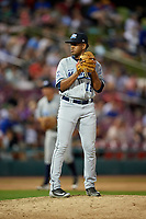 West Michigan Whitecaps relief pitcher Felix Viloria (12) gets ready to deliver a pitch during a game against the Kane County Cougars on July 19, 2018 at Northwestern Medicine Field in Geneva, Illinois.  Kane County defeated West Michigan 8-5.  (Mike Janes/Four Seam Images)