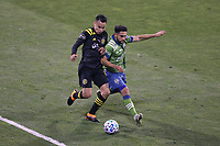 COLUMBUS, OH - DECEMBER 12: Lucas Zelarayan #10 of the Columbus Crew is defended by Cristian Roldan #7 of the Seattle Sounders FC during a game between Seattle Sounders FC and Columbus Crew at MAPFRE Stadium on December 12, 2020 in Columbus, Ohio.