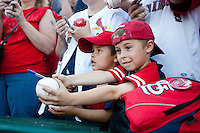 Young fans ask for autographs from St. Louis Cardinals players prior to a game between the St. Louis Cardinals and the Springfield Cardinals at Hammons Field on April 2, 2012 in Springfield, Missouri. (David Welker/Four Seam Images)