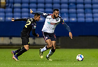 Bolton Wanderers' Reiss Greenidge competing with Newcastle United U21's Rodrigo Vilca (left) <br /> <br /> Photographer Andrew Kearns/CameraSport<br /> <br /> EFL Papa John's Trophy - Northern Section - Group C - Bolton Wanderers v Newcastle United U21 - Tuesday 17th November 2020 - University of Bolton Stadium - Bolton<br />  <br /> World Copyright © 2020 CameraSport. All rights reserved. 43 Linden Ave. Countesthorpe. Leicester. England. LE8 5PG - Tel: +44 (0) 116 277 4147 - admin@camerasport.com - www.camerasport.com