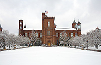 Smithsonian Castle Washington DC<br /> <br /> The Smithsonian Castle, located on the National Mall in Washington, D.C Nicknamed The Castle it was designated a National Historic Landmark in 1965. With multiple, rounded and curved towers, and massive, red sandstone masonry, the Castle serves as a stunning example of Romanesque style that is preserved as the oldest building on the National Mall.