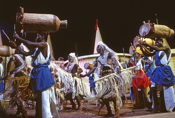 African Pavillion, 1964 World's Fair, Flushing Meadows, New York. Seven foot tall Watusi warriors and a dozen drummers, the personal performers of King Mwambutsa of Burundi, dance a victory celebration. Photo by John G. Zimmerman.