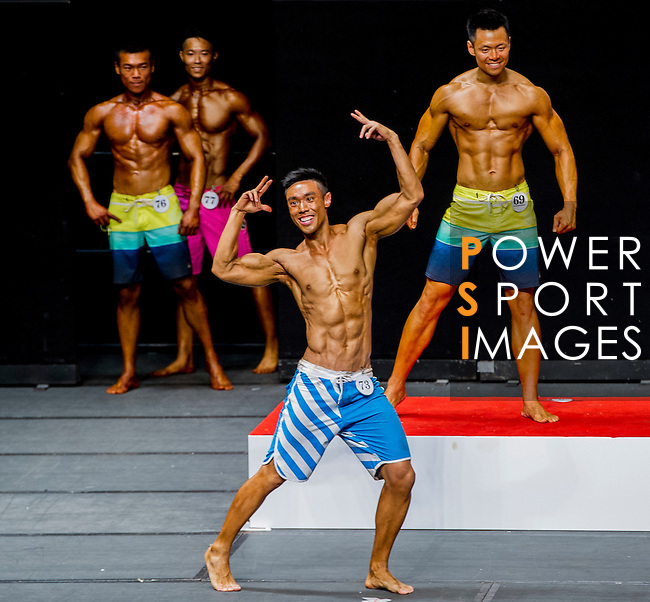 A bodybuilder competes in the Men's Sport Physique 180cm or above (Group D) category during the 2016 Hong Kong Bodybuilding Championships on 12 June 2016 at Queen Elizabeth Stadium, Hong Kong, China. Photo by Lucas Schifres / Power Sport Images