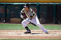 Taylor Lindsey (8) of the Salt Lake Bees bunts against the Fresno Grizzlies in Pacific Coast League action at Smith's Ballpark on May 26, 2014 in Salt Lake City, Utah.  (Stephen Smith/Four Seam Images)