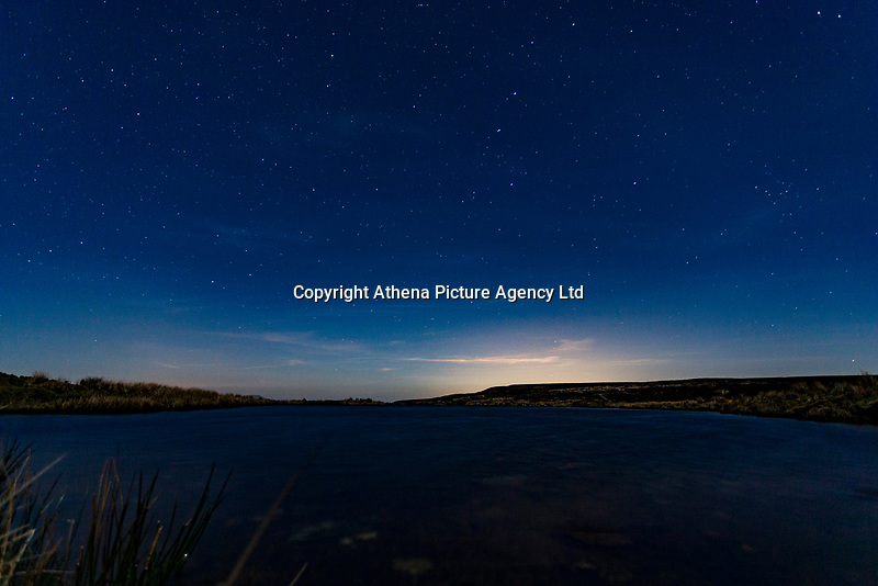Nights Sky, Keepers Pond, Pontypool, Wales, UK.<br /> Re: Below zero temperatures have hit most parts of the UK this month. This month will also have no full moon, a rare phenomenon which only happens during the month February and is known as Black Moon with January and March experiencing Blue Moons.