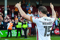 Stephen Warnock of Bradford City thanks Bradford City fans as he retires from football during the Sky Bet League 1 match between Scunthorpe United and Bradford City at Glanford Park, Scunthorpe, England on 5 May 2018. Photo by Thomas Gadd.